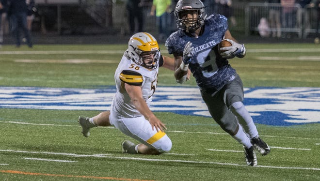 Dallastown's Nyzair Smith break past Red Lion's Evan Paules during football at Red Lion Friday, Nov. 3, 2017. Smith was named to the PIAA Class 6-A all-state team on Monday by the Pennsylvania Football Writers after rushing for a Y-A League-high 2,055 yards and 32 touchdowns. J. Kelley Dentry