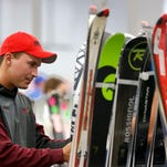 Members of the Great Falls Ski Club make final preparations before the Ski Swap in 2012 in the Trades and Industries Building at Montana ExpoPark.