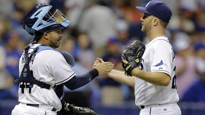 Tampa Bay Rays relief pitcher Brad Boxberger, right, shakes hands with catcher Rene Rivera after closing out the New York Mets