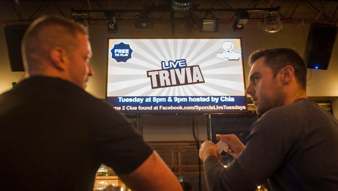 Jon Weiss, 36, of Detroit and John Szambelan, 34, of Detroit, talk prior to the start of a trivia game at Mr B's in Royal Oak on Sept. 27, 2016.