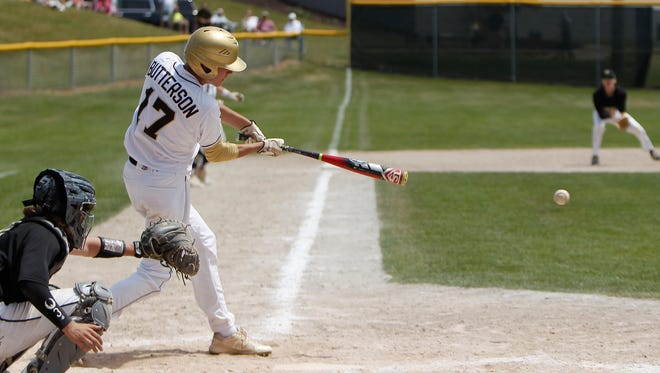 Holt senior Robert Butterson hits a line drive for a two-run RBI in the bottom of the sixth against Howell June 10, 2017, during the regional semifinal at Grand Ledge.  Holt won 3-1.