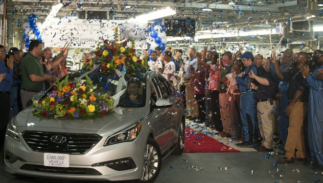 Hyundai Motor Manufacturing Alabama President and CEO J.H. Kim drives  the 3-millionth vehicle made in Montgomery. With Hyundai Motor Manufacturing President J.H. Kim at the wheel, Hyundai rolled its 3-millionth vehicle, a 2015 silver limited edition Sonata, off the line at its Montgomery plant on Tuesday, June 30, 2015.