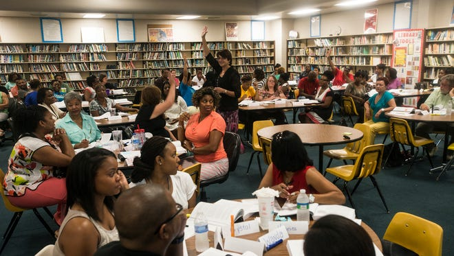 Susan Schist of Safe & Civil Schools, standing, works with Montgomery Public Schools teachers on Wednesday, July 29, 2015, at Brewbaker Middle School during a workshop to help MPS teachers increase classroom effectiveness and improve student achievement on Wednesday, July 29, 2015. The workshop helps teachers with methods to keep students on task, do their best work and teach students to behave respectfully.