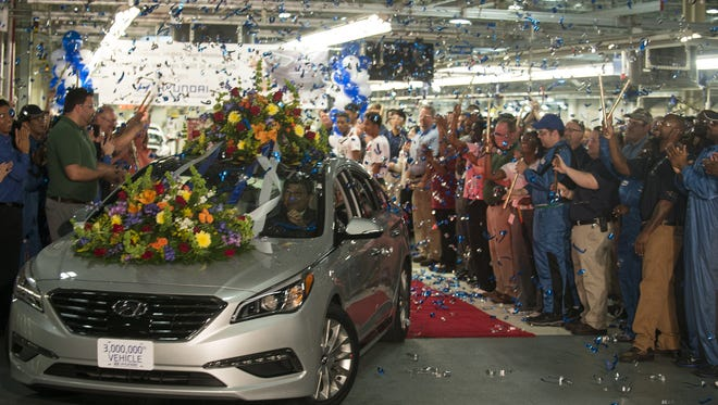 With Hyundai Motor Manufacturing President J.H. Kim at the wheel, Hyundai rolled its 3-millionth vehicle, a 2015 silver limited edition Sonata, off the line at its Montgomery plant on Tuesday, June 30, 2015.