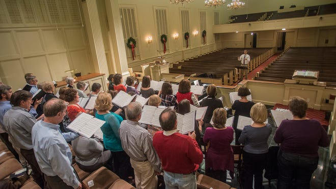 Todd Alexander, director of music at Trinity Presbyterian Church in Montgomery, leads the choir as they practice for the 20th annual Service of Lessons and Carols on Wednesday, Dec. 9, 2015. The service takes place at Trinity at 4 p.m. and 6 p.m. on Sunday, Dec. 20.