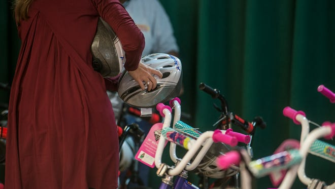 A total of 30 bikes and helmets from Academy Sports + Outdoors were given away to students in third and fourth grades at Prattville Elementary School on Friday, Dec. 11, 2015.