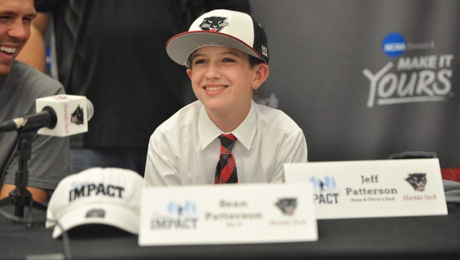 Sean Patterson is all smiles after trading his West Virginia hat for a Florida Tech one.