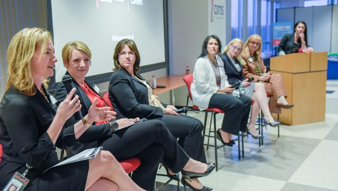 Speaking (at left) at a Women in Technology panel at iCIMS Tuesday is panelist Jennifer Scandariato, director of test engineering for iCIMS.
