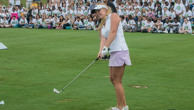 Stephanie Meadow came in second after a tiebreaker at the Yokohama Tire Global Challenge, a preliminary event for this week's Yokohama Tire LPGA Classic at the Robert Trent Jones Golf Trail in Prattville, Ala., on Tuesday, May 3, 2016. Players had to hit balls through tires arranged like the Olympics symbol. Alabama graduate Meadow (representing Ireland) was one player from 5 countries who are potential Olympians or who have represented their country on Solheim Cup teams. Other participants were Brittany Lincicome (United States), Gaby Lopez (Mexico),  Mariajo Uribe (Colombia), and the winner, Caroline Masson (Germany).
