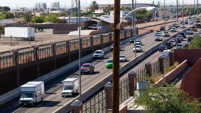 Looking North, Northwest Grand Avenue is seen here near  West Glenn Drive on Wednesday, April 13, 2016, in Glendale, Ariz. The proposed Glendale light rail would go through this area.
