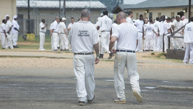 Elmore Correctional Facility opened in 1981 to hold 600 inmates; it now holds 1,176. Inmates are in the yard on Thursday, July 17, 2015, at Elmore Correctional Facility in Elmore.