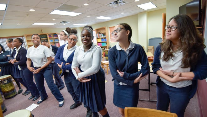 """The Sisters Academy of New Jersey, Asbury Park, has thrived with minority girls for decades. Music students perform """"The Light Comes Down."""" /Russ DeSantis for the Asbury Park Press / Slug: Sisters Academy in Asbury Park"""