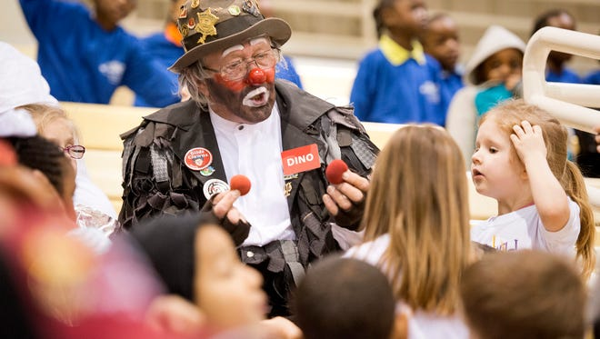 March 19, 2015 - Dino the clown, portrayed by Dean Brown, performs sleight-of-hand tricks for children before the start of the 2015 Al Chymia Shrine Circus inside the Showplace Arena at Agricenter International.