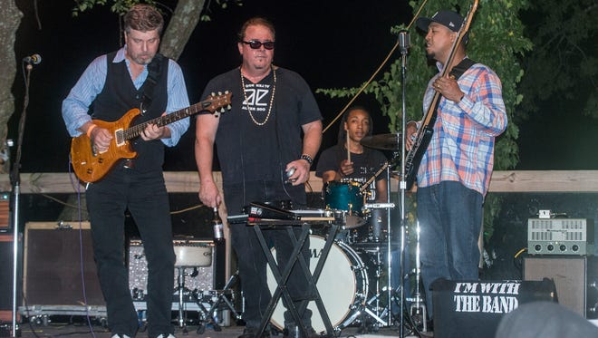 King Bee performs on stage. A fundraiser for John Bull and Ed Pickett's upcoming trip to the International Blues Challenge in Memphis, Tennessee was held Thursday, Oct. 5, 2017, at Capitol Oyster Bar in Montgomery.