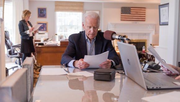 Former vice-president Joe Biden reads the news on Biden's