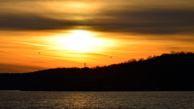 The sun sets over Lake Hopatcong on the Winter solstice in 2015.