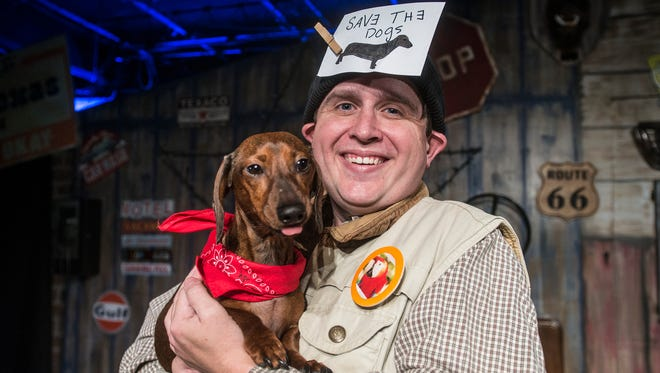 """David Brown holds Rudy, who plays Yippy the dog. """"Greater Tuna,Ó directed by Kristy Meanor, runs at the Wetumpka Depot through Feb. 17."""