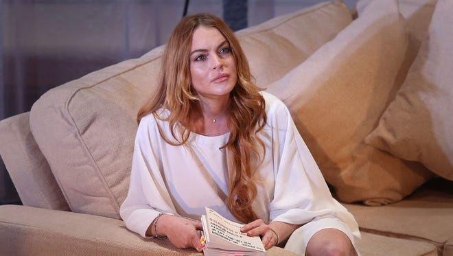 "Actress Lindsay Lohan performs a scene from the play, ""Speed the Plow,"" during a photocall at the Playhouse Theatre in central London on Sept. 30, 2014. Lohan's wreckless driving case is scheduled to be called in a Los Angeles court on Thursday, May 7, 2015, to update the judge on her progress with community service."