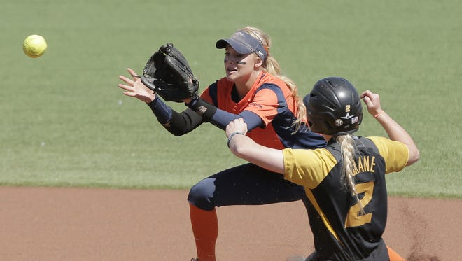Missouri's Emily Crane slides safely into second base as UTEP second baseman Courtney Clayton waits for the throw during Monday's game.