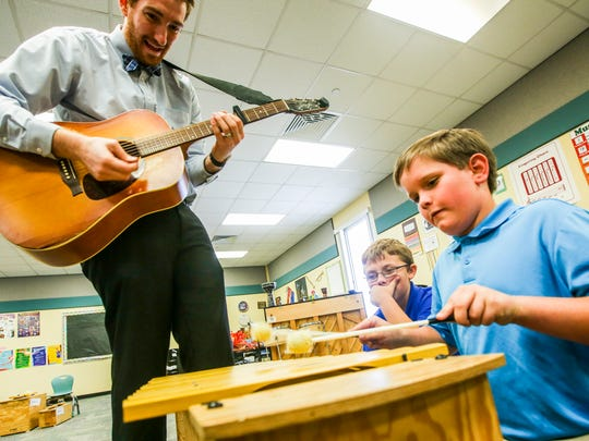 """Music teacher Jason Thomashefsky, 26, teaches students in grades kindergarten through fifth at Rayma C. Page Elementary School. He helps his fifth-graders compose and write a song. """"I had one group last year write about their favorite food and how it makes them feel, but they put it in like the style of a sad ballad,"""" Thomashefsky said."""