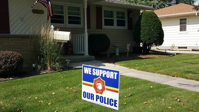 Purchase locations have been announced for police support yard signs.