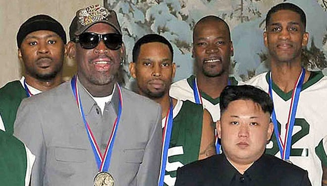 This photo taken on Jan. 8, 2014, and released by North Korea's official Korean Central News Agency shows North Korean leader Kim Jong-Un,  front right, with former U.S. basketball star Dennis Rodman, left.