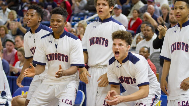 Lafayette Christian players react to action near the end of the Knights' 54-47 loss to Arcadia in the LHSAA Boy's Top 28 Semi-Finals in Lake Charles March 10, 2016.