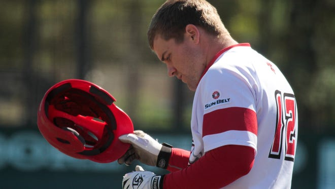 UL's Joe Robbins, showing here removing his helmet after flying out against Little Rock earlier this season, was named Sun Belt Player of the Week on Monday.