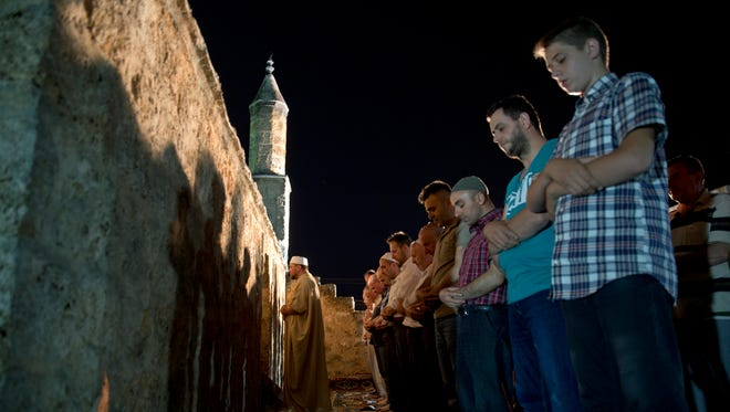 Imam leads taraweeh prayers with Muslim devotees during the holy month of Ramadan at the Namazgah mosque in southern Kosovo city of Prizren on early Saturday, June 18, 2016. Taraweeh prayer is performed only during the holy month of Ramadan and were held in the Namazgah mosque differently known as the Broken Mosque, which was build during the Ottoman rule in 1455 the first mosque built in Kosovo.