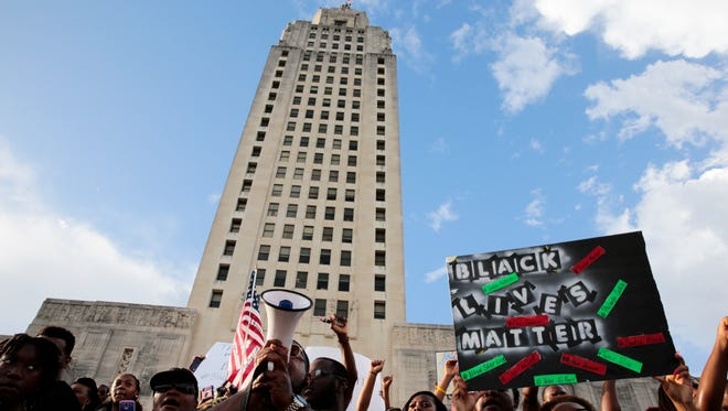 Demonstrators gather  the steps of the state capitol during a protest against the July 5 shooting of Alton Sterling, an African-American shot dead while being taken into custody by two white police officers, in Baton Rouge July 9, 2016.