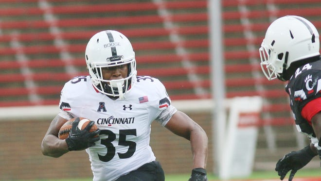 University of Cincinnati running back Taylor Boose carries the ball during the Bearcats' scrimmage on Aug. 13.