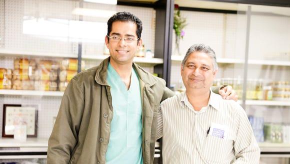 Jatinder Bhardwaj, left, and his father Anand Sharma