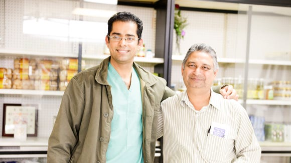 Jatinder Bhardwaj, left, and his father Anand Sharma recently opened Desi Spice Bazaar in Lafayette.