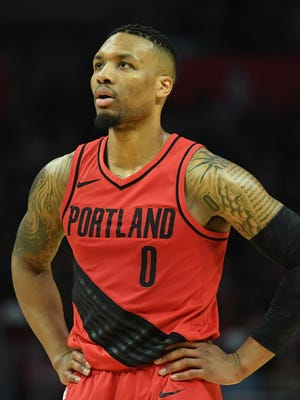 Portland Trail Blazers guard Damian Lillard reacts in the second half against the LA Clippers at Staples Center.