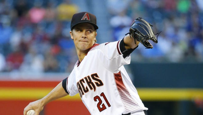 Diamondbacks starting pitcher Zack Greinke throws against the Dodgers during the first inning of their game at Chase Field on Monday night.