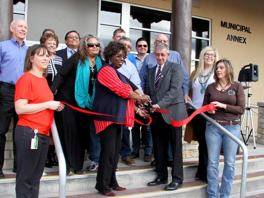 City councilors, Carlsbad Mayor Dale Janway and city employees cut the ribbon for the new municipal annex.