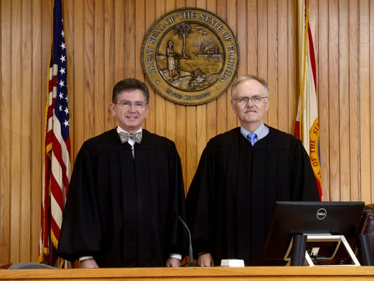 Circuit Judges T. Michael Jones and Terry Terrell hang up their robes at the end of the year