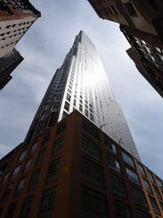 Pictured is the large skyscrape at 8 Spruce St. in