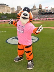 Paws, the mascot for the Detroit Tigers, honors those