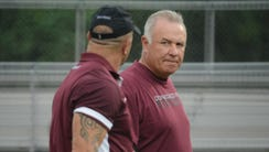 Supporters of former Don Bosco head football coach