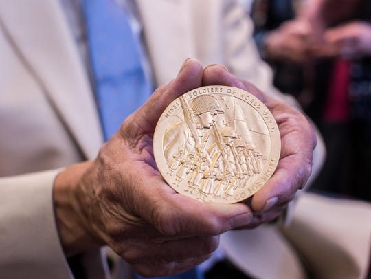 "Tsugio ""Tug"" Ikeda holds his Congressional Gold Medal."
