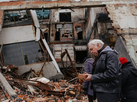 World-renowned Berlin club owner Dimitri Hegemann looks at bricks from a section of the vacant Fisher Body Plant No. 21 while taking a tour on Nov. 26, 2014.