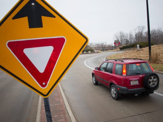 A car passes through the roundabout in Coralville.