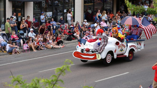 Clowns on the Shriners car entertain the crowd during the parade in downtown Great Falls on July 4, 2014.