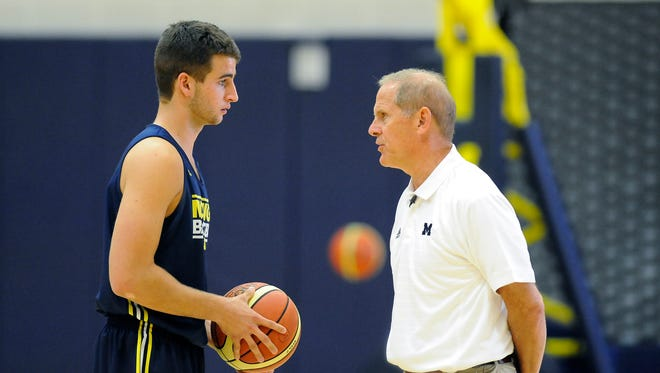 Michigan head basketball coach John Beilein talks to freshman Austin Hatch during practice at UM's Crisler Center, Wednesday morning, August 13, 2014. (Photo by Lon Horwedel/Special to the Free Press)