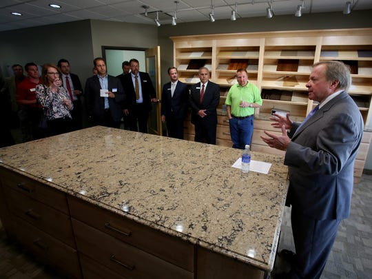 Edsel Ford II, the chairman and owner of Pentastar Aviation, talks with employees and others inside the new interior design studio upstairs on one of their hangers at their large complex at the Oakland County International Airport in Waterford, Michigan on Friday,  September 25, 2015.