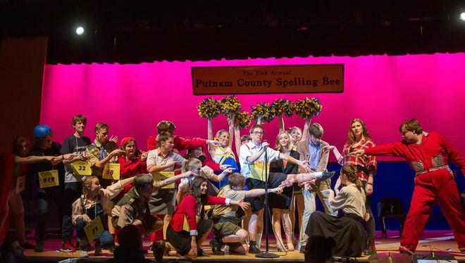 The cast of The 25th Annual Putnam County Spelling Bee celebrates the magical properties of William Barfee's (Hank Slaby) magic foot.