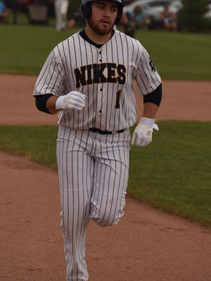 Notre Dame High School senior Drew Chiprez trots toward third base after hitting a three-run homer in the first inning against Winfield-Mount Union in the district tournament Saturday night. Notre Dame won, 20-0.