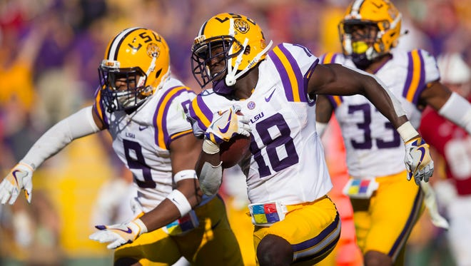 LSU Tigers cornerback Tre'Davious White (18) returns an interception for a touchdown during the third quarter against the Wisconsin Badgers at Lambeau Field.
