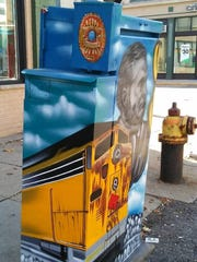"A utility box mural features a tribute to Greg ""Ziggy"""